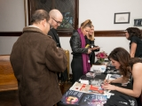 Jacquie and Liz signing CDs
